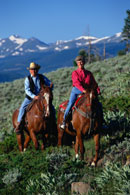 Horseback riding in mountains; Size=130 pixels wide